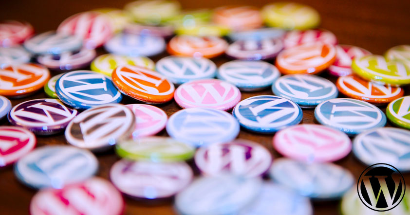 A bunch of multi-colored WordPress logo buttons